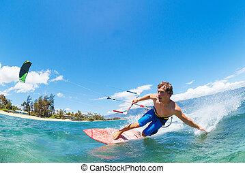 Kiteboarding - Young Man KiteBoarding, Fun in the ocean,...