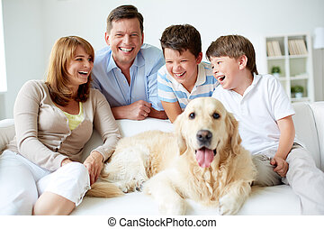 Happy weekend - Portrait of happy family with their pet...
