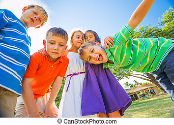 Happy Group of Young Kids - Group of Happy Kids Playing...