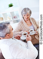 Tea time - Portrait of mature man and his wife drinking tea...
