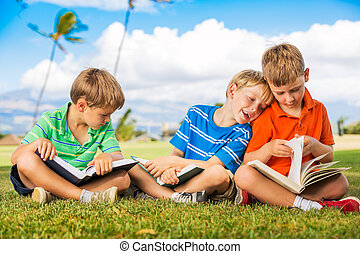 Kids Reading Books - Group of Happy Kids Reading Books...