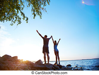 Energetic morning - Photo of young couple standing on the...