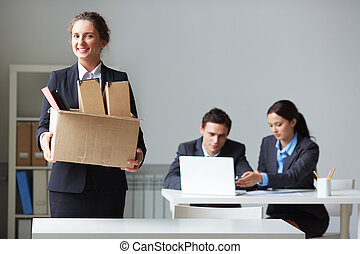 New co-worker - Portrait of smart businesswoman with box...