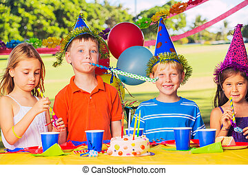 Kids Birthday Party - Group of adorable kids at birthday...