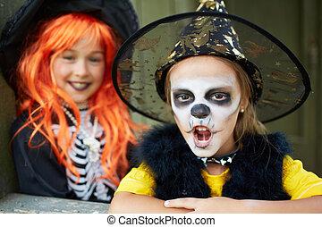 Halloween horror - Portrait of Halloween girls looking at...