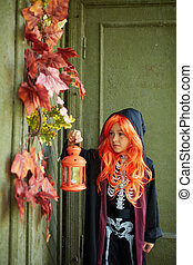 Trick or treat - Portrait of Halloween girl with lantern...