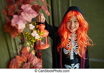 Girl with lantern - Portrait of Halloween girl with lantern...