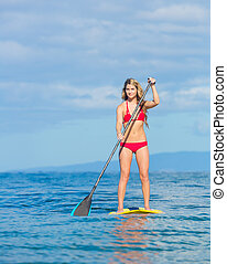 Woman on Stand Up Paddle Board - Young Attractive Woman on...