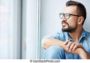 Pensive man - Calm man in denim shirt and eyeglasses looking...