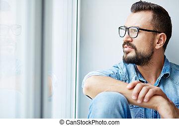 Pensive man - Calm man in denim shirt and eyeglasses looking...