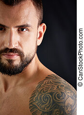Man with tattoo - Head and shoulder portrait of handsome guy...