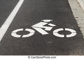 Bike Lane - White paint on a road designating the space as a...