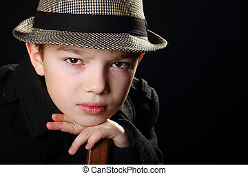 Boy with a hat - Young boy wearing a hat on black background