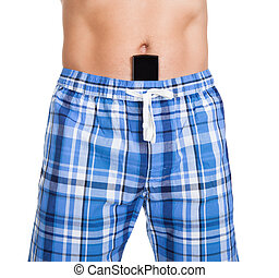 Man with cell phone in shorts - Close-up of shirtless man...