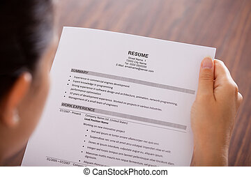 Young Businesswoman Reading Resume - Close-up Of Young...