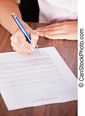 Woman Signing The Contract Paper - Close-up Of Female Hand...