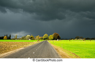 autumn sky - A road towards a dark autumn sky in the...