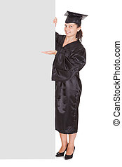 Graduate woman holding blank placard over white background