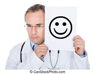Doctor holding paper with smiling face