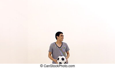 Man juggling a ball, bullet time - Man juggling a football...