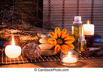 dried flowers, white stones, candles on bamboo mat