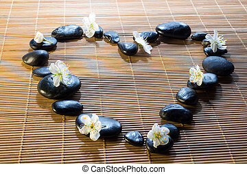heart with black stones and flower