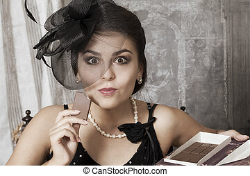 Pretty female eating a chocolate - Beautiful young pin-up...