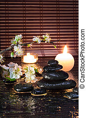 almond flowers with candles and black stones