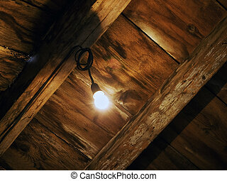 Light in the attic - Old house attic, with sight on the...