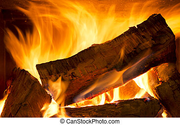 Wood Fire - Logs of wood burning bright in a wood fire