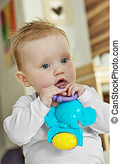 Cute baby girl with a toy