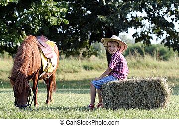 happy boy and pony horse on farm