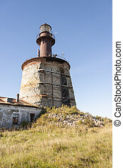 Ancient lighthouse on an island - Ancient half broken...