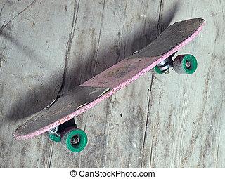Old skateboard - Old battered skateboard in grunge style