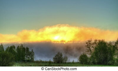 Sunrise through the mist. True HDR. Bright colors and high...