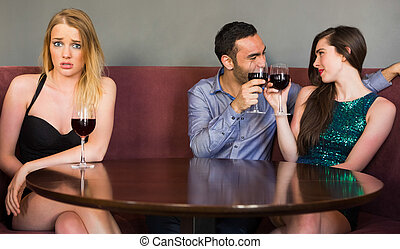 Blonde woman feeling jealous as two people are flirting...