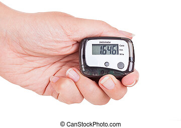Hand Holding Digital Pedometer - Close-up Of Hand Holding...