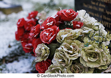 flowers on gravestone - Red and cream flowers on a...