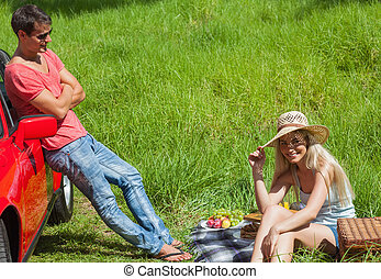 Happy couple having picnic together on a sunny day