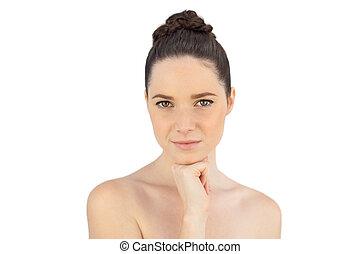 Pensive natural woman posing