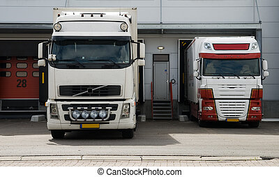 big trucks at loading dock - big trucks at a loading dock