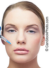 Content beautiful model having botox injection above the...