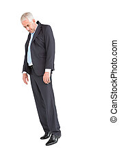 Businessman hanging against white background