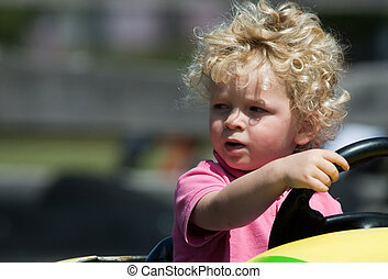 boy having fun in car - cute young boy having fun in yellow...