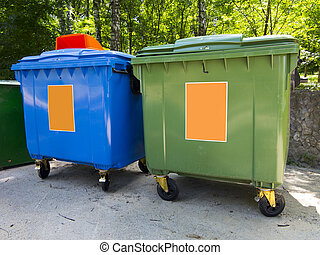 New colorful plastic garbage containers in park - New...