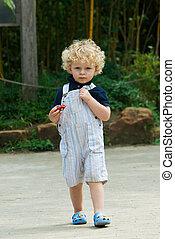 cute young boy walking in summer