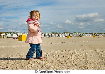 cute young girl on the beach - cute young girl having fun on...