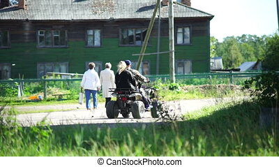 Man riding ATV bike in a village - KARELIA, RUSSIA -...