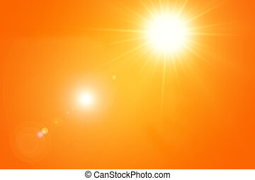 Bright sun with lens flares on orange summer sky