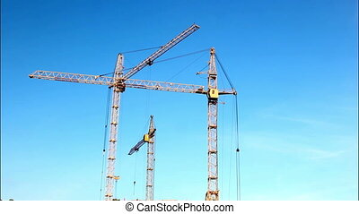 time-lapse tower crane - tower cranes working on a...